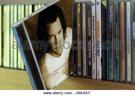 Forever and Ever, Randy Travis CD pulled out from among other CD's on a shelf, Dorset, England - Stock Photo