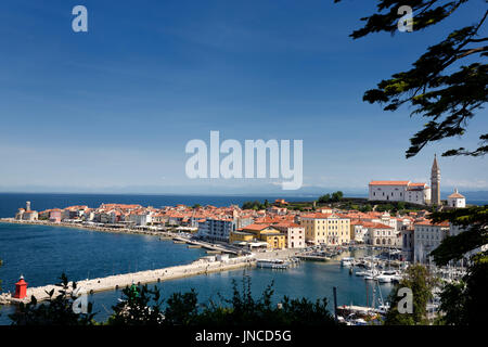 Piran Slovenia Gulf of Trieste on the Adriatic sea from the Punta Lighthouse to St George's Cathedral with Kanin - Stock Photo