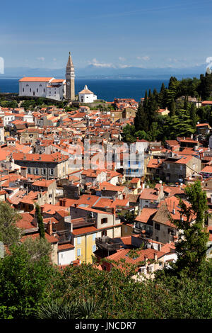 Aerial view of Piran Slovenia with St George's Cathedral on the Gulf of Trieste with snow capped Kanin mountains - Stock Photo