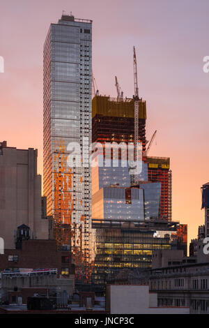 The Hudson Yards construction site (2017) and The Eugene skyscrapers at sunset. Midtown, Manhattan, New York City - Stock Photo