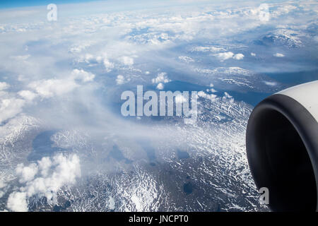 Broken cumulus cloud seen from above looking down over mountains, western Norway - Stock Photo