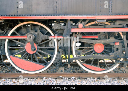 Close up of old steam locomotive wheels. - Stock Photo