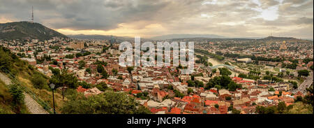 Panoramic view of Tbilisi, the capital of Georgia with old town and modern architecture during sunset. - Stock Photo