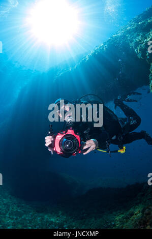 Underwater photographer at 'El Arco' dive site at Ses Salines Natural Park at Formentera (Balearic Islands, Spain) - Stock Photo