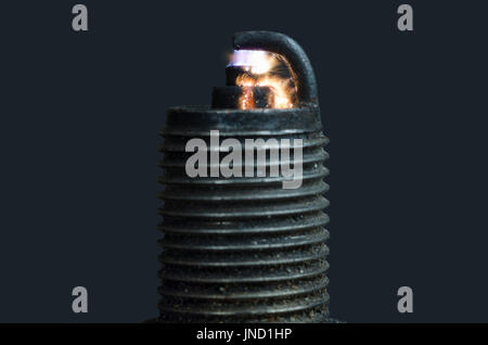 Old broken dirty spark plug with amazing sparkle; isolated - Stock Photo