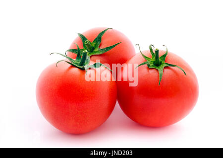 Three fresh raspberry tomatoes isolated on white background - Stock Photo