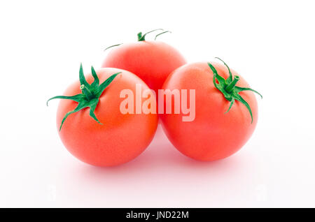 Three juicy tomatoes isolated on white background - Stock Photo
