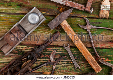 Old vintage hand tools on wooden background - Stock Photo