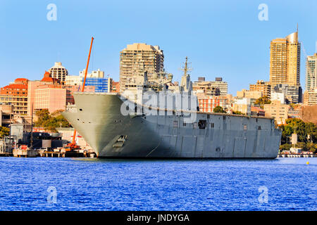 Lead flagship landing helicopter carrier of Canberra-class docked in Sydney Woolloomooloo cowper wharf on military - Stock Photo