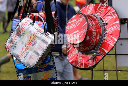 Lulworth, Dorset, UK. 29th July, 2017. Camp Bestival Day 3 - Bags and hats made of recycled coke and pepsi cans - Stock Photo