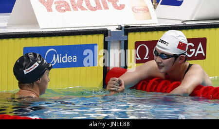 Budapest. 29th July, 2017. China's Li Bingjie (R) shakes hands with Katie Ledecky of the U.S. after the women's - Stock Photo