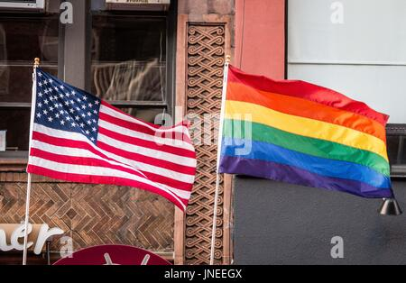New York City, New York, USA. 29th July, 2017. The LGBTQ Pride flag and the United States flags flown together in - Stock Photo