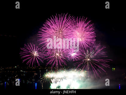 Vancouver, BC, Canada.  29th July, 2017.  Bright pink fireworks burst in the sky above the waters of English Bay - Stock Photo