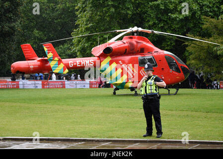 London's Air Ambulance G-EHMS landed on the green space between Birdcage Walk and Buckingham Palace in response - Stock Photo