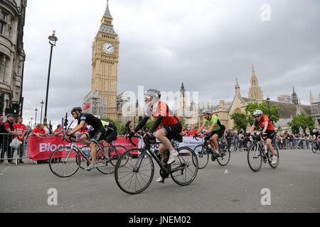 London, UK. 30th July, 2017. Riders passes Big Ben in the Prudential London-Surrey 100 cycle challenge. Thousands - Stock Photo