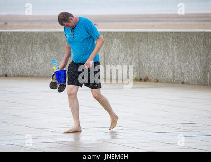 Seaton Carew, county Durham, England, UK. 30th July, 2017. Weather: Sunshine and heavy showers at Seaton Carew on - Stock Photo