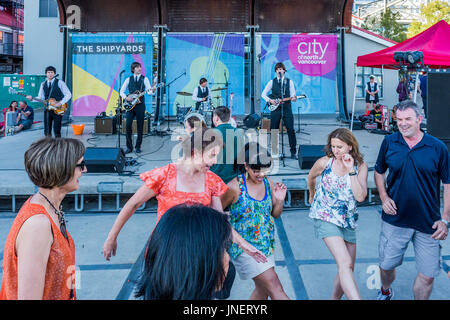 Vancouver, Canada. 29th July, 2017. Beatles cover band  The Day Trippers play The Shipyards at Shipbuilders Square, - Stock Photo