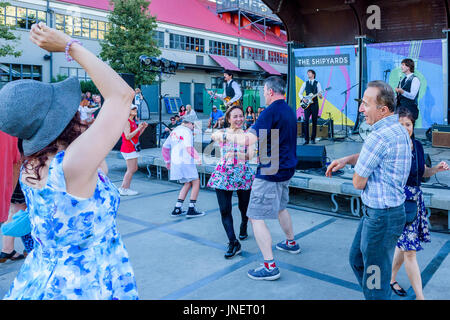 Vancouver, Canada. 29th July, 2017. Crowd dances to Beatles cover band  The Day Trippers play The Shipyards at Shipbuilders - Stock Photo
