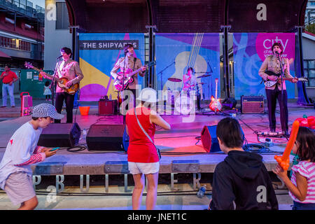 Vancouver, Canada. 29th July, 2017. Audience dances to Beatles cover band  The Day Trippers play The Shipyards at - Stock Photo