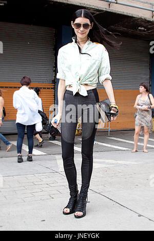 Street Style. Model off duty: Ming Xi asian fashion model wearing sunglasses during New York Fashion Week - Stock Photo