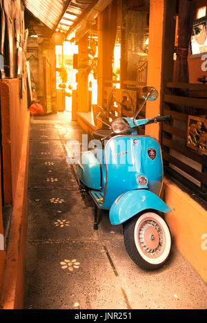Bali, Indonesia - July 04, 2017. Blue Vespa brand scooter in a place in Ubud Bali Idonesia. - Stock Photo