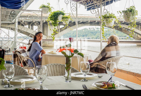 Food Set On The Deck With Woman In Background On A Yacht Sailing ...