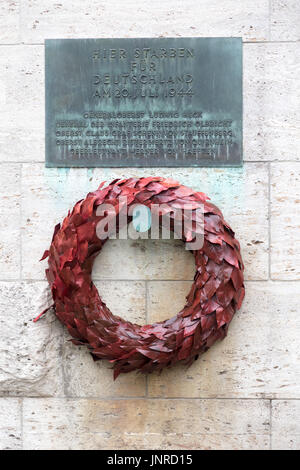 Plauqe and wreath in memory of Claus von Stauffenberg and others who conspired to assassinate Adolf Hitler in 1943 - Stock Photo