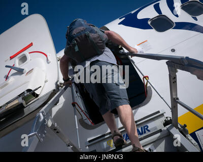 Passengers boarding Ryanair aircraft with boarding pass - Stock Photo