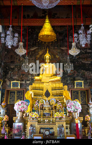 Sitting buddha statue inside the Ubosot at Wat Arun Temple (Temple of Dawn) in Bangkok, Thailand - Stock Photo