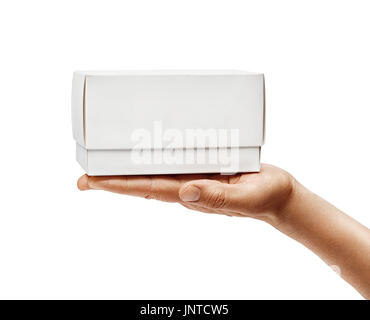 Man's hand holding white box isolated on white background. Close up. High resolution product - Stock Photo