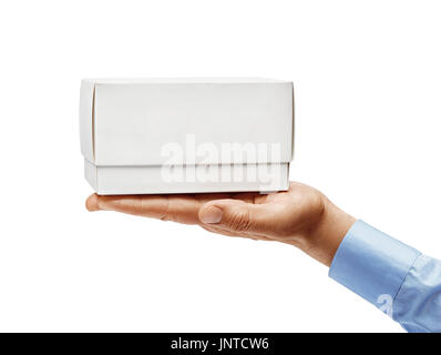 Man's hand in a shirt holding white box isolated on white background. Close up. High resolution - Stock Photo