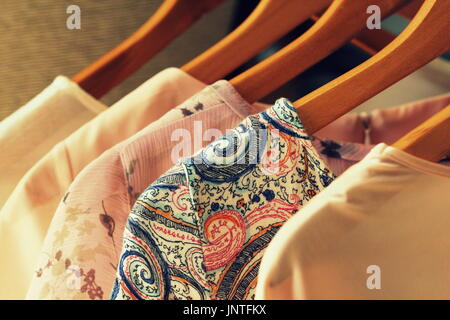 b7f8687c4a6 A row of womens clothes on a hanger in a shop for sale Stock Photo ...