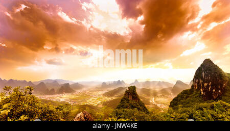 View on sunset over karst landscape from moon hill in yangshuo - Stock Photo