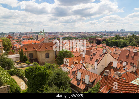 Few tourists at a vantage point and scenic view of the Mala Strana District (Lesser Town) and beyond in Prague, - Stock Photo