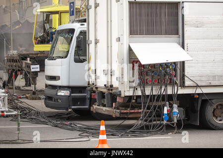 Temporary outdoors mobile distribution station, close-up view of power cables and sockets. - Stock Photo