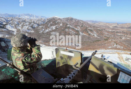 SEOUL, South Korea - A South Korean soldier stands guard near the military demarcation line with North Korea on Dec. 19, 2011. North Korea said the same day its leader Kim Jong Il had died. (Pool photo by Kyodo News)(Kyodo)
