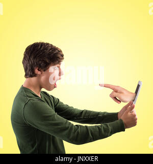 Hand indicating comes out of the tablet - Stock Photo