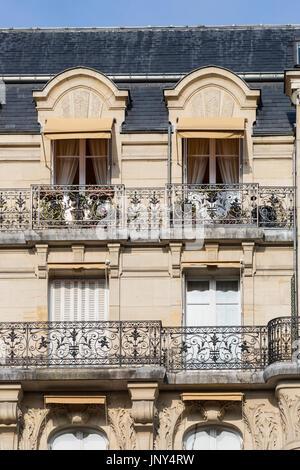 Paris. France - February 27, 2016: Haussmann apartment buildings in the 7th arrondissement in Paris, France. - Stock Photo