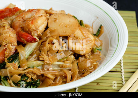 Stir fried flat rice noodle or char kway teow - Stock Photo