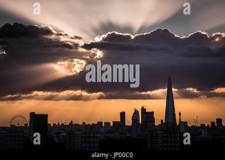 London, UK. 31st July, 2017. UK Weather: The Shard skyscraper building with dramatic sunrays during sunset © Guy - Stock Photo