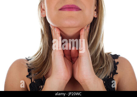 Picture of young woman having sore throat holding her neck, checking the inflamed glands - isolated background - Stock Photo