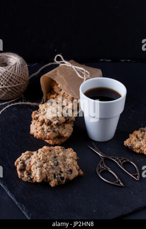 Oatmeal cookies and coffee - Stock Photo