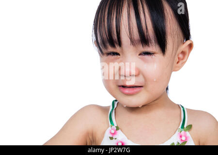 Crying Asian Chinese little girl in isolated white background - Stock Photo
