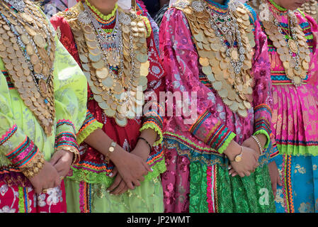 Dressed girls with gold coin necklaces, Assumption Day, Olympos, Karpathos Greece - Stock Photo