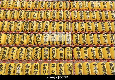 Lantern displays name of people who gave financial donation to Yasukuni Shrine in Tokyo Japan. - Stock Photo