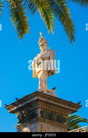 Sassari Sardinia piazza, statue of King Vittorio Emanuele II sited on top of a column in the centre of the Piazza - Stock Photo