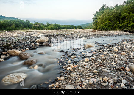River bed of a fast mountain river - Stock Photo