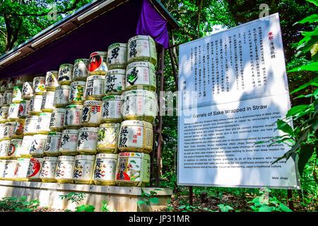 TOKYO, JAPAN - MAY 15: Barrels of sake wrapped in straw in Meiji Shrine temple in Shibuya, Tokyo - Stock Photo
