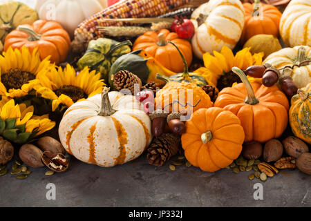 Fall still life with pumpkins, nuts, wheat and corn - Stock Photo