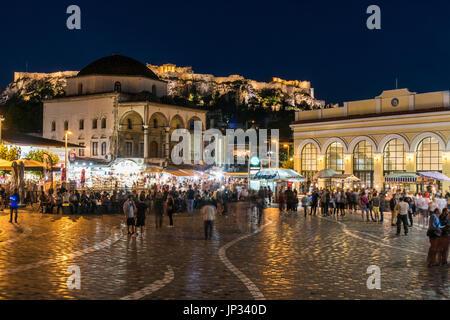 Night view of Monastiraki square with Acropolis in the background, Athens, Attica, Greece - Stock Photo